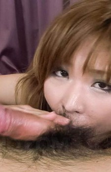 Ai Sakura Asian rubs cock between cans and licks it so erotically