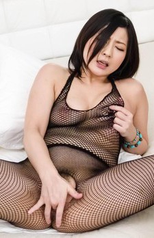 Megumi Haruka in fishnet outfit rubs cock between her boobies