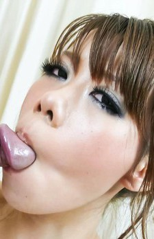Sakura Aragaki Asian with big eyes sucks penis head with passion