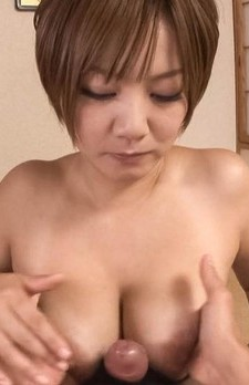 Meguru Kosaka Asian licks penis she puts between her fine boobs