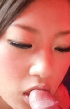 Satomi Suzuki Asian kisses cock head and rubs it between boobs
