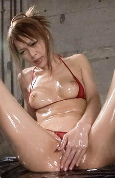 Rina Asian caresses her curves with oil and sucks two shlongs
