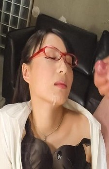 Kokona Sakurai with specs gets cum on face after stroking cocks