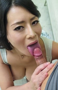 Rei Kitajima Asian has huge cans out of top while licking penis