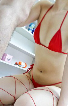 Toa Asian nymph sucks boner and rubs it with feet in red strings