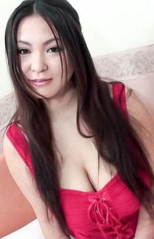 Airi Ai Asian chick licks cock between her generous knockers