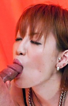 Kaoru Amamiya Asian with exposed tits plays with mouth on penis